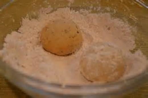 Roll balls in powdered sugar