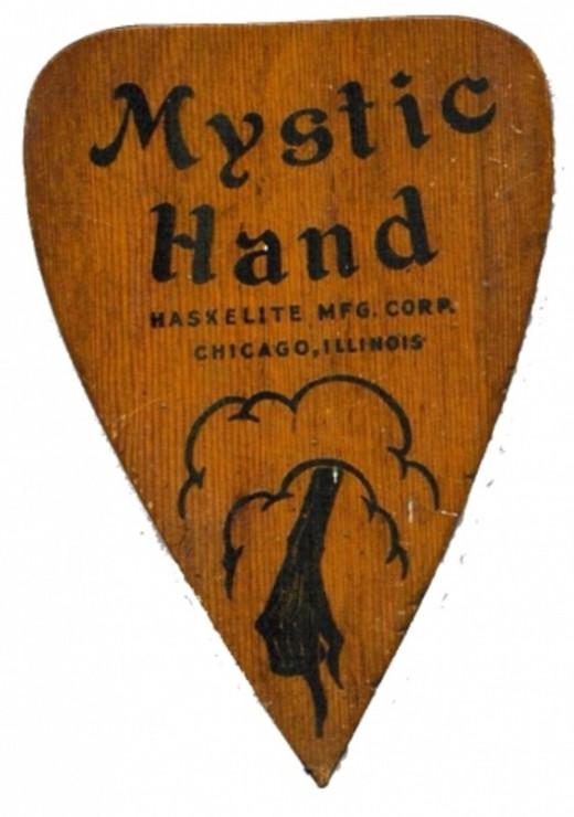 """Mystic Hand planchette c.1940"" by Original work: Museum of the MacabreDepiction: Museum of the Macabre . Licensed under Fair use via Wikipedia"