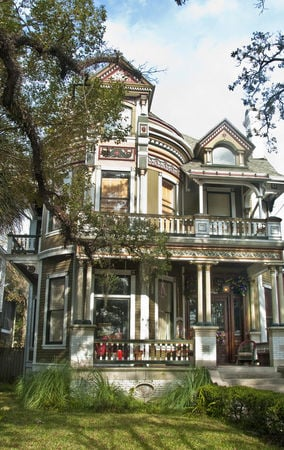 An Oakleigh Garden District area Queen Anne Victorian home on Government Street, once home to wealthy cotton brokers.