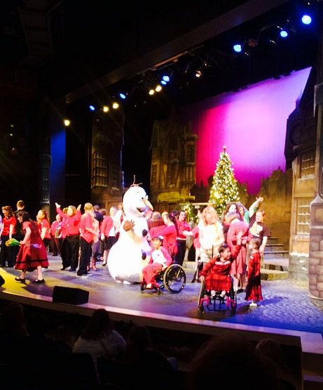 Olaf dances with participants in a Christmas Concert and Lily.