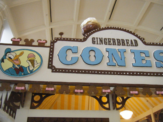 Each side of the gingerbread complex as a different Disney character on the sign.