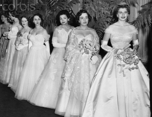 Debutantes in perfect lines greet their friends