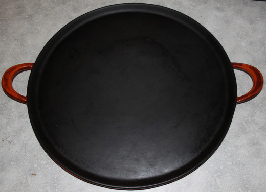 I acquired this lovely enameled cast iron pizza pan from an online Canadian kitchen shop. It's perfect for baking sourdoughs, yeast breads, biscuits, cookies or anything else headed for the oven. I love cooking with cast iron!
