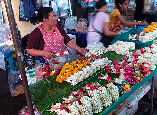 Vendors making phuang malai (flower garlands)