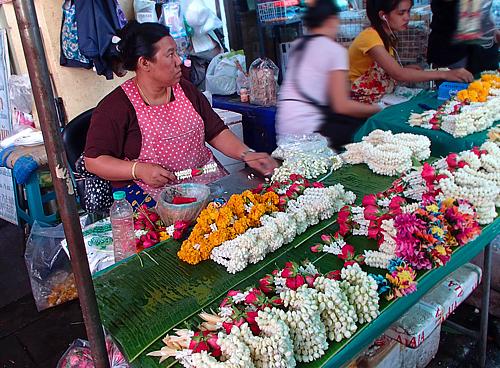 Vendors making phuang malai (flower garlands)