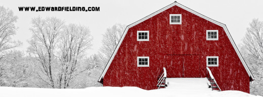 Beautiful red barn in Etna, New Hampshire in the middle of a snowstorm.  Fine art photography by Edward M. Fielding