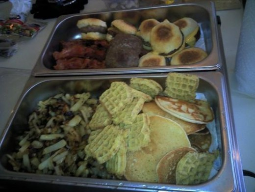 Breakfast Party Layout: Sausage/cheese biscuit sandwiches, cinnamon waffles, pancakes, scrambled eggs, cheese omelette bites, bacon, hashbrowns (diced and seasoned potatoes cooked with onions).