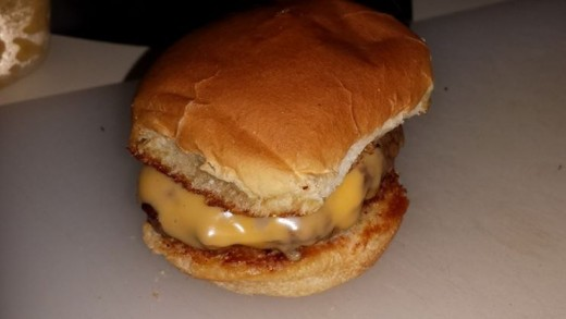 """Cheeseburgers on garlic bread buns. """"Slider"""" size buns were buttered and then browned in a pan sprinkled with garlic salt.   Not a required step, but it's amazing."""