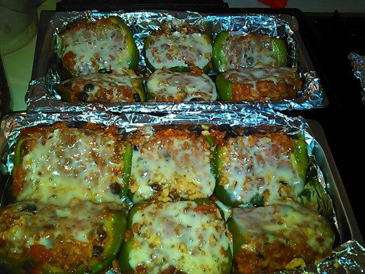 Stuffed green peppers - halved to serve. Cook hot sausage with ground beef. Add raisins, tomato soup, diced tomatoes, rice.  Bake until pepper softens.  Top with walnuts and pepper jack cheese.