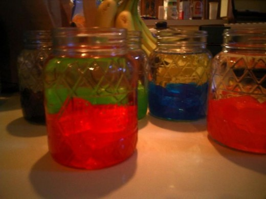 Jolly Rancher Vodka: Local stores sell rather inexpensive jars that are easy to clean and use again.  We stored some jars in the freezer for a year and it still tasted amazing.  Very easy to make.