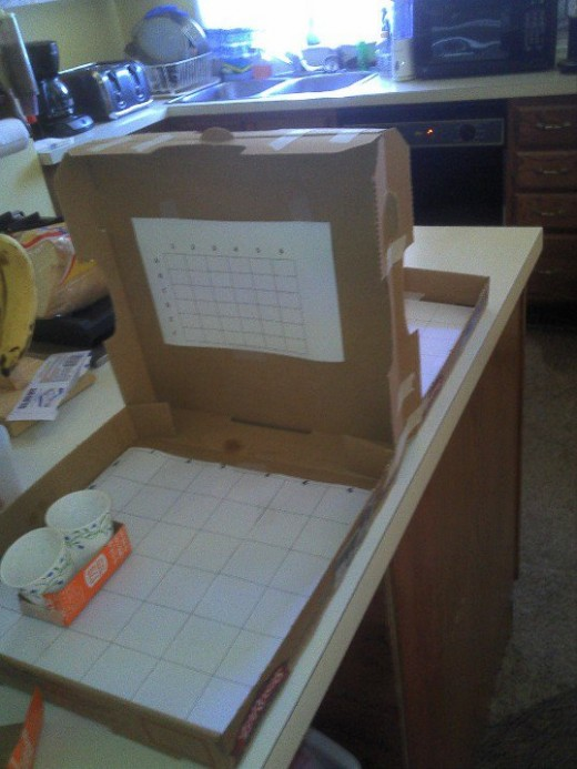 Battle Shots game made from old pizza boxes.