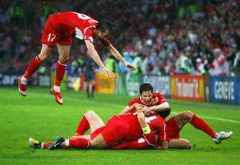 Tuncay Sanli (17) dives in as he celebrated with Nihat Kahveci after Turkey came from behind to take the lead against the Czech Republic. The victory sent Turkey into the quarter-finals of Euro 2008.