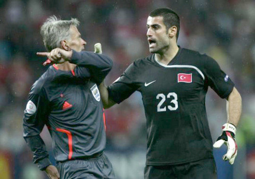 Referee Peter Frödjfedlt tells Volkan Demirel to leave the game after sending off the goalkeeper. Fröjdfelt retired from international football when he turned 45 in November.