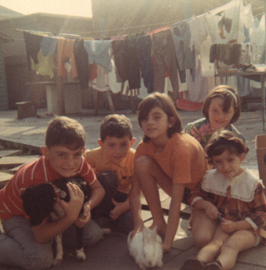 My siblings and me (I'm on the right) ca. 1968.  If you look in the background, you can see one of our early clotheslines lining the backyard.