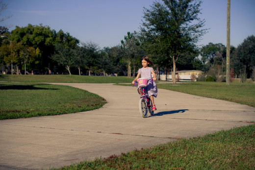 Girl riding bike in neighborhood