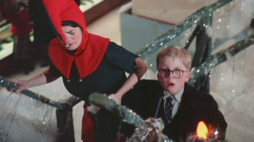 The Head Elf (Patty Johnson) roughs up Ralphie (Peter Billingsley) on his way to see Santa.