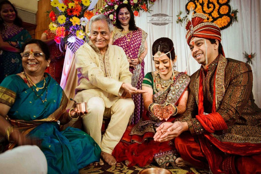 In India, the reverence to the institution of marriage and family bondage are very strong. When a woman marries, she literally marries a family.