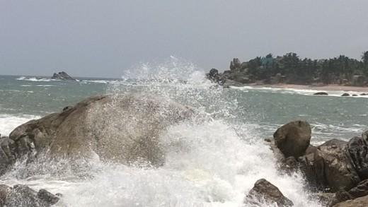 Sea waves of Tri-Sea hitting the rocks