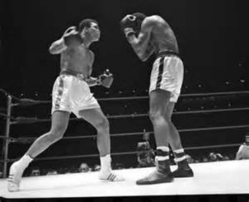 Ernie Terrell(on right) seen here fighting Muhammad Ali briefly held the WBA Heavyweight title.