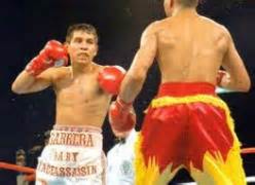 Kennedy McKinney (Right) is seen waging war with Marco Antonio Barrera. McKinney and Barrerra fought a Fight of the Year candidate.