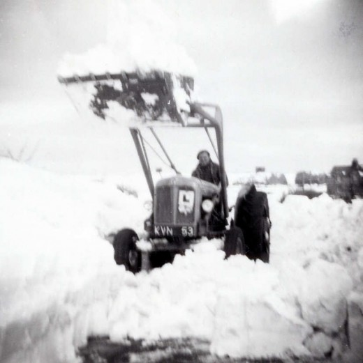 A tractor at Loftus in East Cleveland (North Yorkshire) getting to grips with stuck vehicles, 1963
