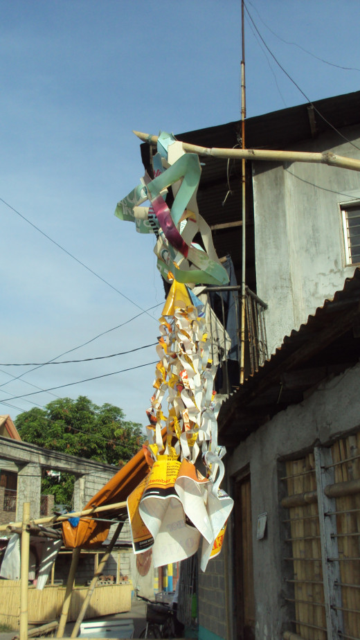 When it rains, the paper decorations get wet and feeble. You can hardly distinguish the tail from the body of this parol.