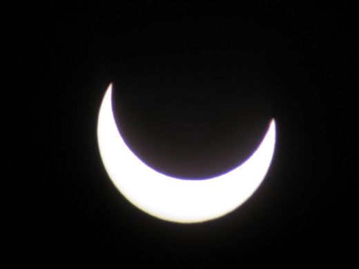 Solar Eclipse: 6:54 PM - The sun puts on a happy face