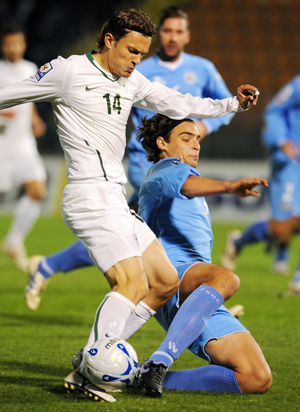 Zlatko Dedic (14) of Slovenia battles for possession with San Marino's Davide Simoncini in a World Cup qualifier on Oct. 14, 2009. Slovenia won the match 3-0 to clinch a play-off for a spot at the World Cup.
