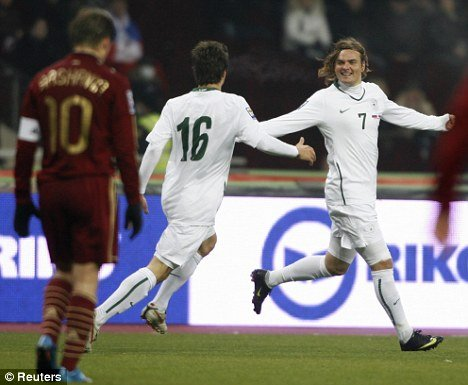 Nejc Pecnik (7) celebrates with Dalibor Stevanovic after scoring against Russia in Moskva during a World Cup play-off. Pecnik's goal proved vital in Slovenia's road to the World Cup.