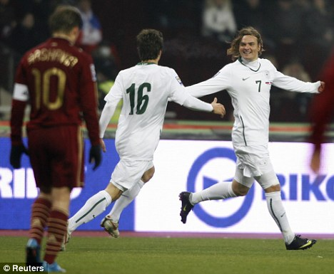 Nejc Pecnik (7) celebrates with Dalibor Stevanovic after scoring against Russia in Moscow during a World Cup play-off. Pecnik's goal proved vital in Slovenia's road to the World Cup.