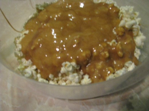 Pour caramel mixture over popcorn