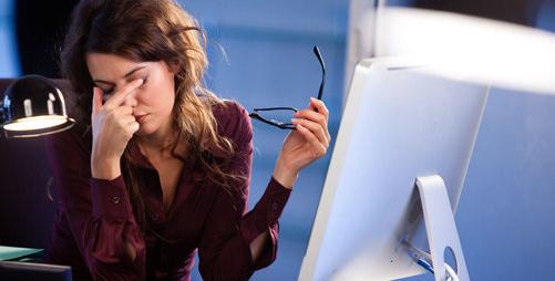 Women Working on Computer Suffering from Eyestrain