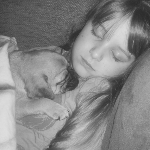 My granddaughter Krystal and her new puppy Buddy.
