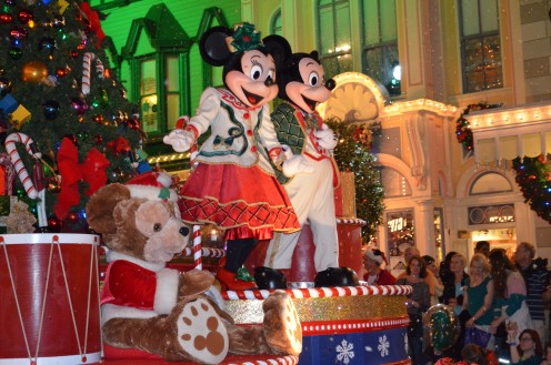 "The host and his girlfriend welcome guests to ""Mickey's Very Merry Christmas Party"" at The Magic Kingdom at Walt Disney World."