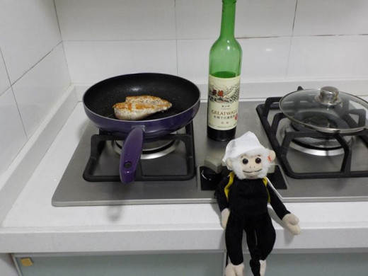 Mooch cooking on a Chinese stove.