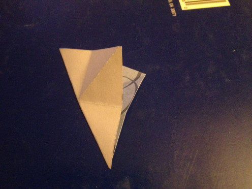 4. Fold in half the other way with corners and back sides together.