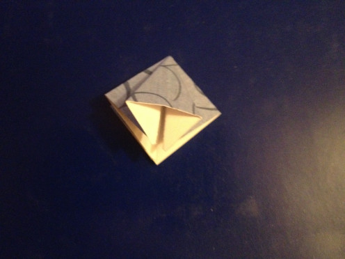 4.  Push the center of the put straight down.  The fold will line up with the split.