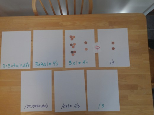 The 3-9's place value tokens are traded and turned in to 9-3's value tokens and added to the 2 tokens already there.
