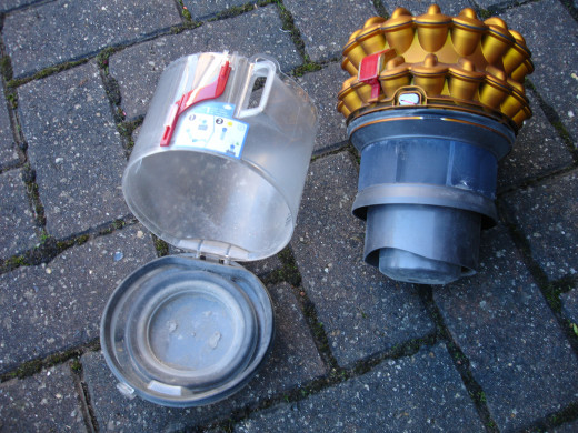 The two main parts of the Dyson bagless cylinder dirt collection device