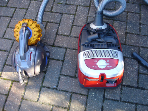 Dyson and Miele vacuum cleaners side by side