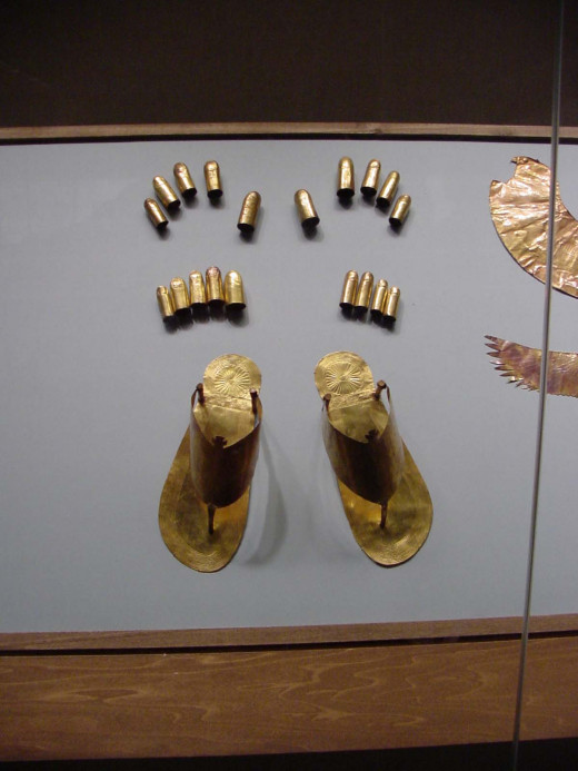A pair of sandals, finger coverings and toe coverings also worn by pharaoh.