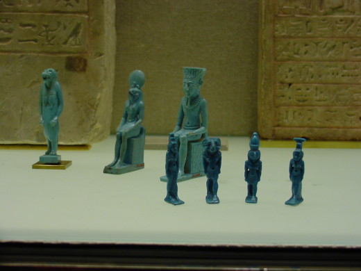 Small statues made of a glass like substance called faience.  Small figures representing servants to serve in the afterlife or gods to protect in the afterlife, were placed in tombs.