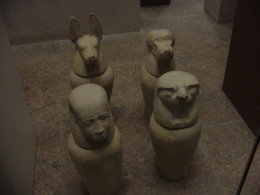 Four canopic jars on display at the Met.
