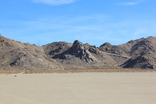 One view of Chimney Rock from across the dry lake bed.