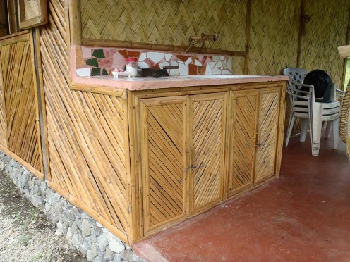 This was the first bamboo project. A sink stand and cupboard that attached to the bamboo pump house and shower room. I used recycled broken tiles for the top of the sink stand.