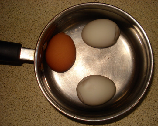 Rest the Hard-boiled Eggs in Cold Water, then Peel off the Shells.