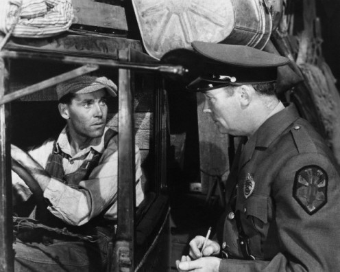 "The late Henry Fonda (in truck) talks with police officer about his truck in iconic film, ""The Grapes of Wrath"""