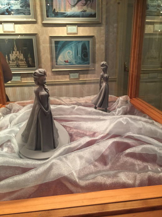 Anna and Elsa clay statues