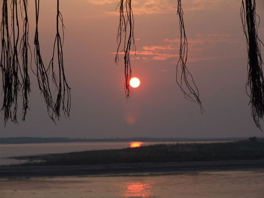 A very different view and color of the sun in this photo.  This one is called sunset at Padma river