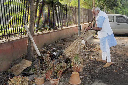 Modi cleaning roadside dust for Swachh Bharat Abhiyan